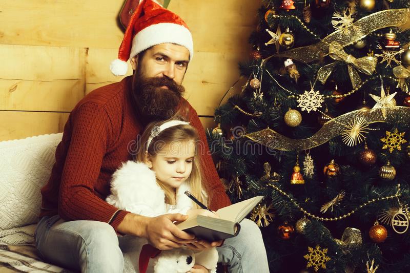 Christmas bearded father and girl writting royalty free stock photography