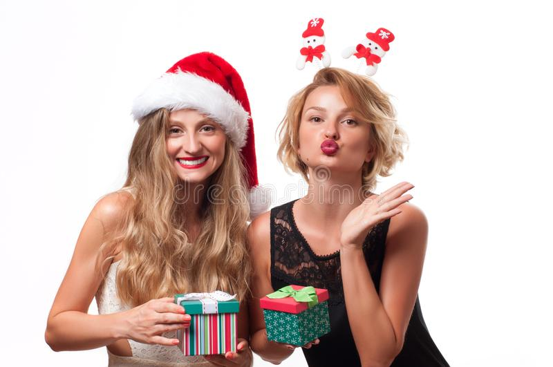 Christmas. Beautiful girls wear santa hat with christmas gift stock photos