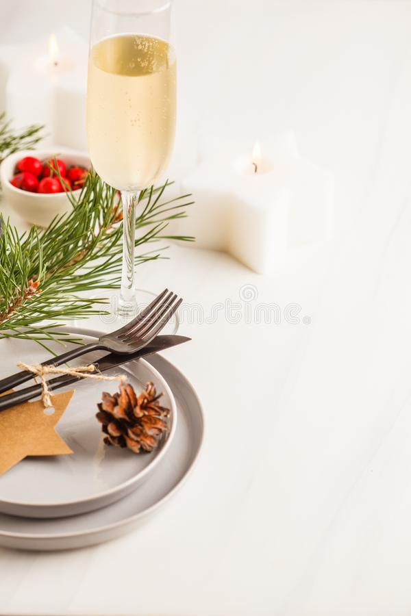 Christmas beautiful table setting with champagne and candles. Ch royalty free stock photos