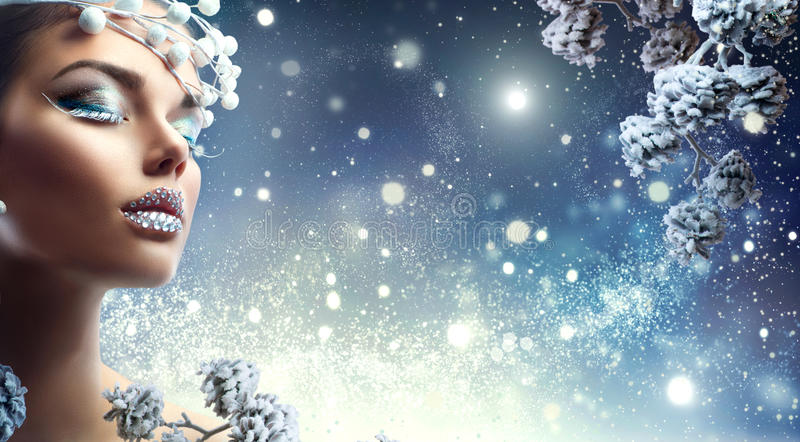 Christmas beauty girl. Winter makeup with gems on lips. Christmas beauty girl. Winter holiday makeup with gems on lips