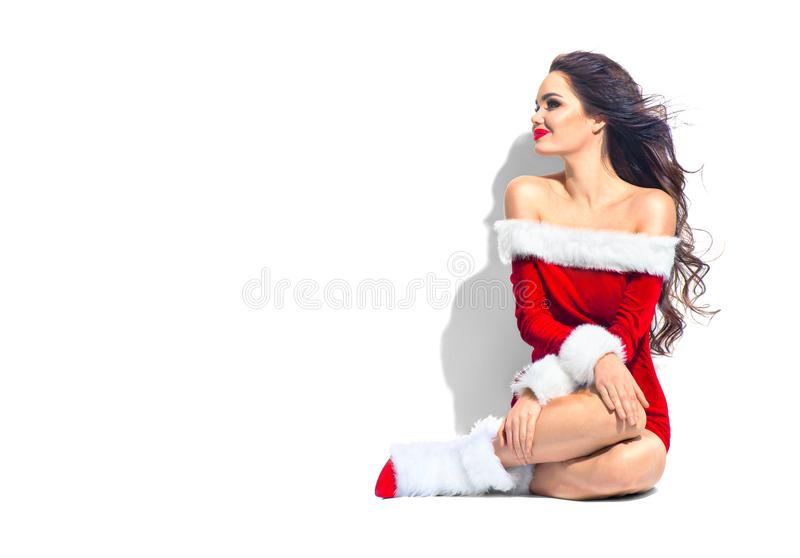 Christmas beauty model girl. brunette young woman wearing red dress royalty free stock image