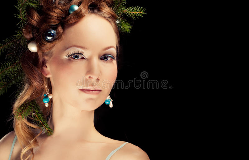 Christmas beauty woman.Holyday make up . False eyelashes,art christmas adornment. Copy space for your text royalty free stock images
