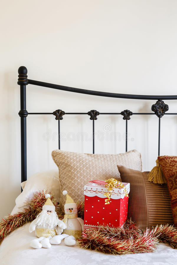 Christmas bedroom copyspace. Christmas interior of contemporary bed against a neutral wall royalty free stock images