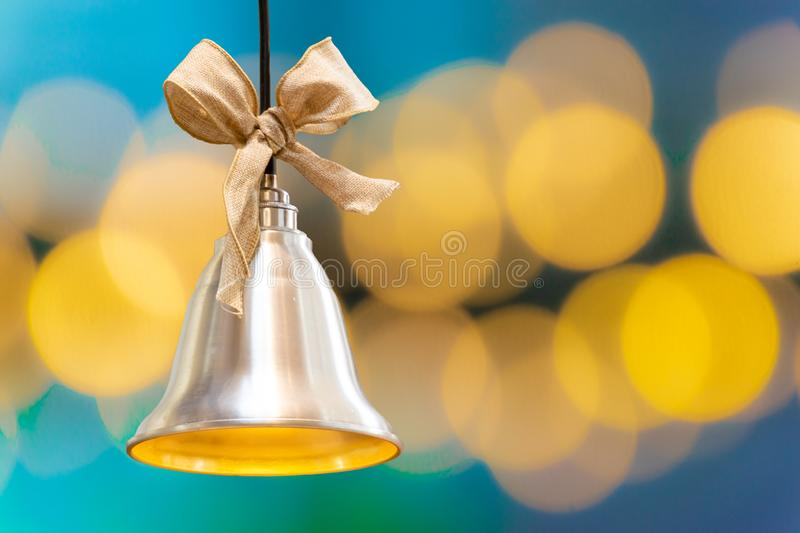 Christmas bell on the background of bokeh lights with copy space royalty free stock photo
