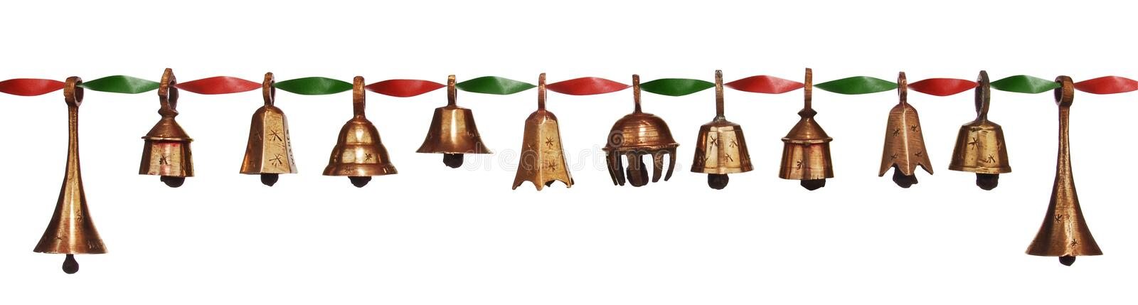 Christmas Bells. Stylish antique Christmas bells assorted on a red twisted ribbon