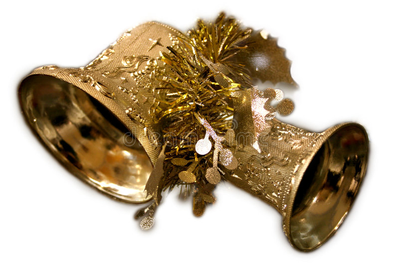 Christmas Bells. Two gold-toned bells adorned with other gold-colored decorations. Background masked out royalty free stock images