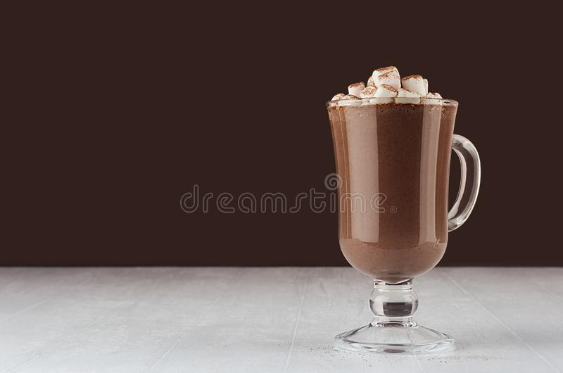 Christmas beverage - hot chocolate in mug with marshmallows, cocoa powder  in elegant dark brown interior, copy space. Christmas beverage - hot chocolate in mug stock images
