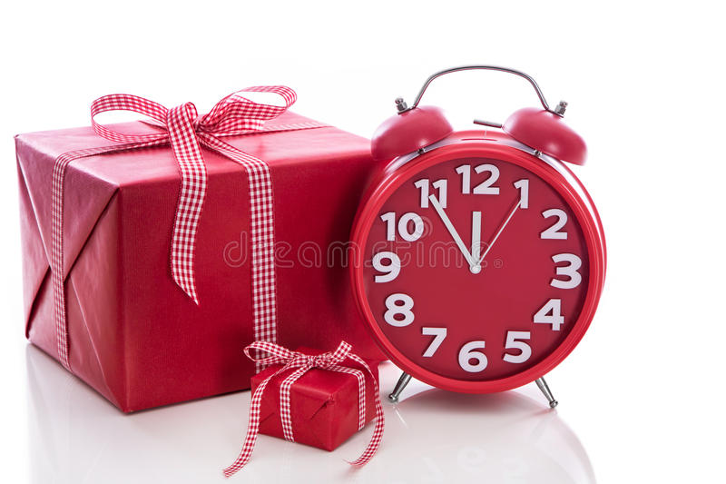 Christmas: big red gift box with red alarm clock - last minute c stock photos