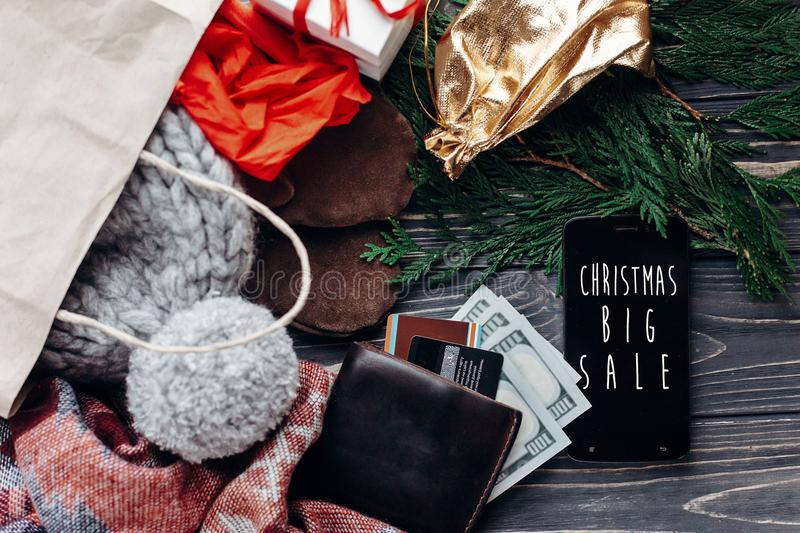 christmas big sale. special christmas offer discount text on phone screen message on seasonal rustic background with money cards stock image