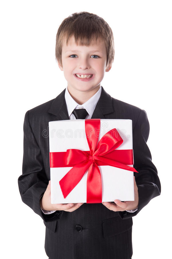 Christmas or birthday concept - little boy in business suit with stock photo