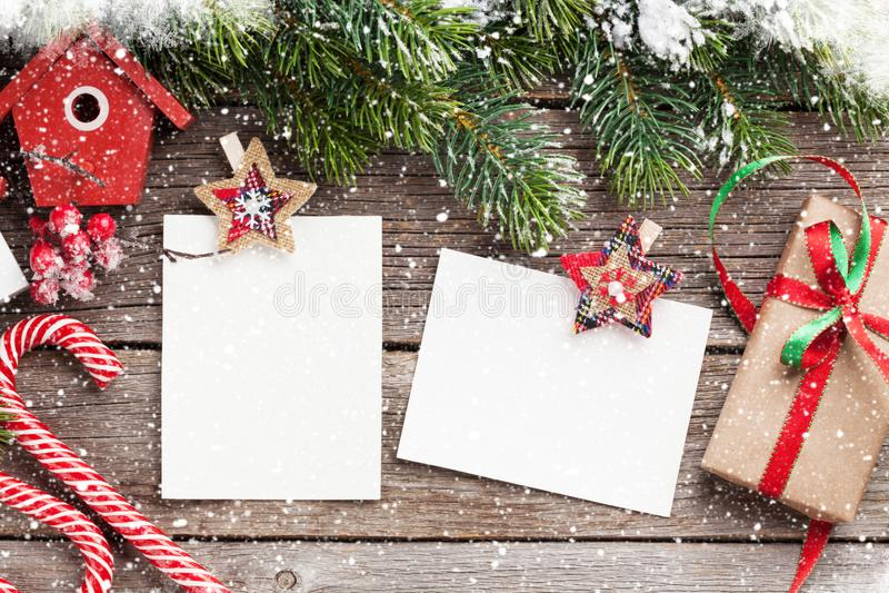 Christmas blank photo frames, birdhouse decor royalty free stock photo