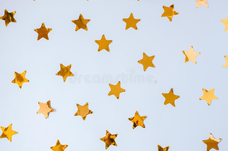Christmas blue background with a lot of golden stars. royalty free stock photos