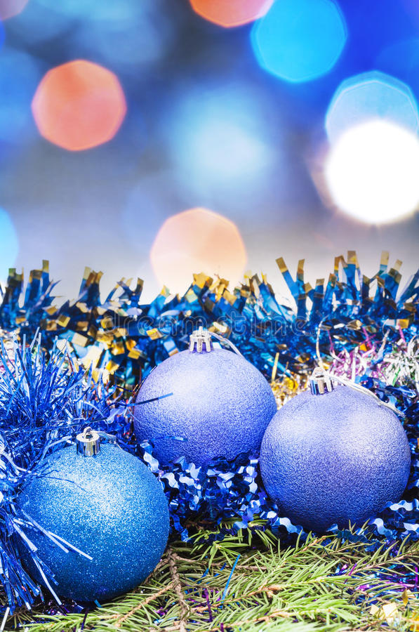 Christmas blue balls on blurred blue background stock photography