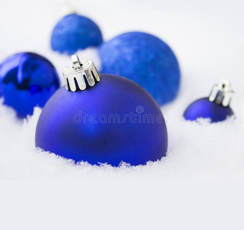 Christmas blue decorations on snow background stock photography