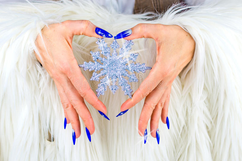 Christmas blue nails stock photography