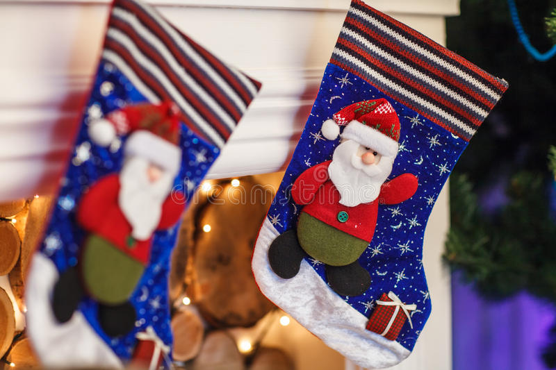 Christmas blue stocking hanging from a mantel or fireplace, decorated for. Christmas blue stocking hanging from a mantel or fireplace, decorated for stock images