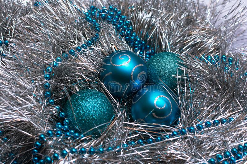 Christmas blue toys lie on a festive silver tinsel, top view royalty free stock photos