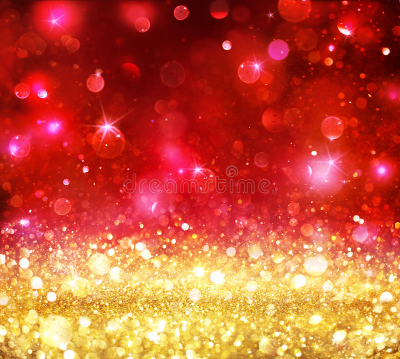 Christmas Bokeh - Golden Glitter With Shining Red royalty free stock image