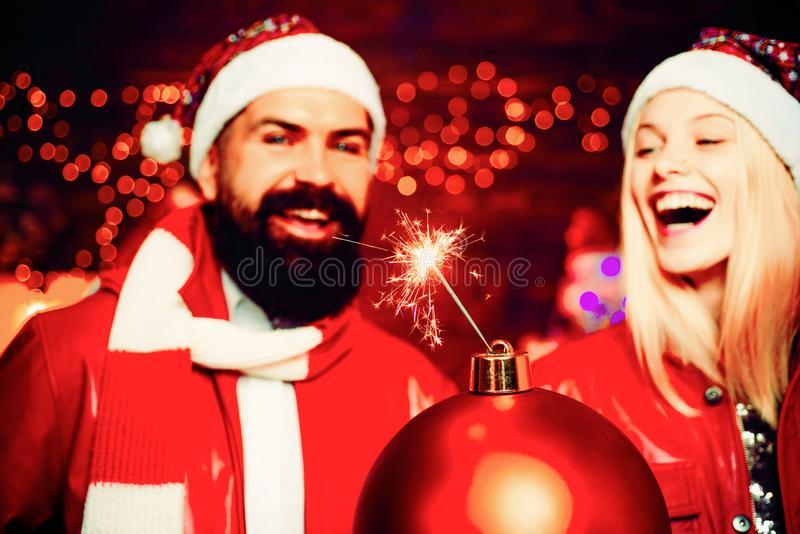 Christmas bomb. Creative boom. Handsome bearded hipster Santa with smiling positive young woman. Expression and people. Concept. Fashion couple over Christmas stock photos