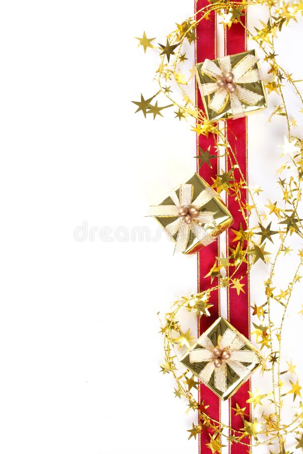Christmas border. From gift box,gold star,red ribbon royalty free stock photos