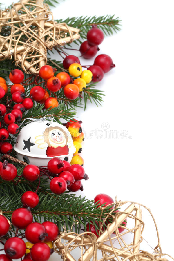 Christmas border. With jingle bell, stars and berries isolated on white background. Shallow dof stock photo