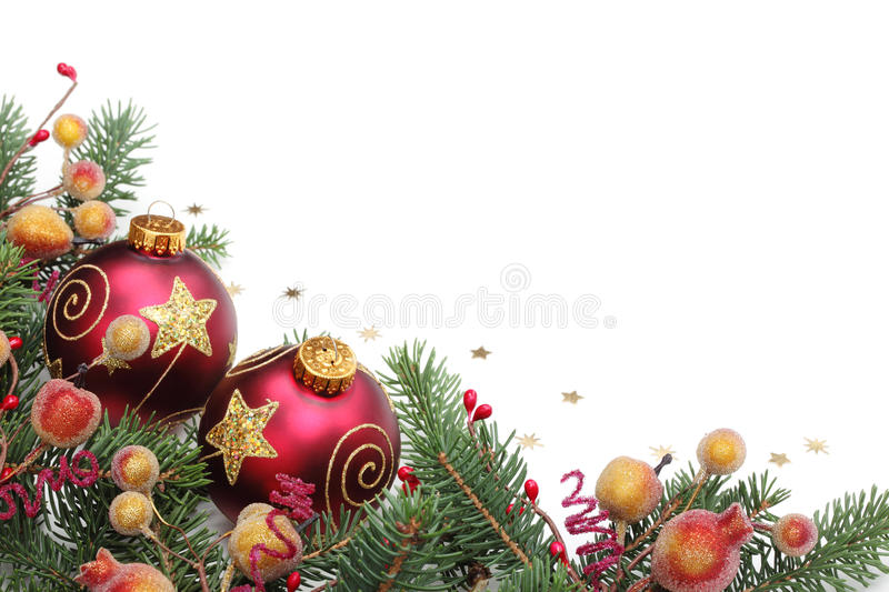 Christmas Border. Pine branches,berries and balls for Christmas border stock photos