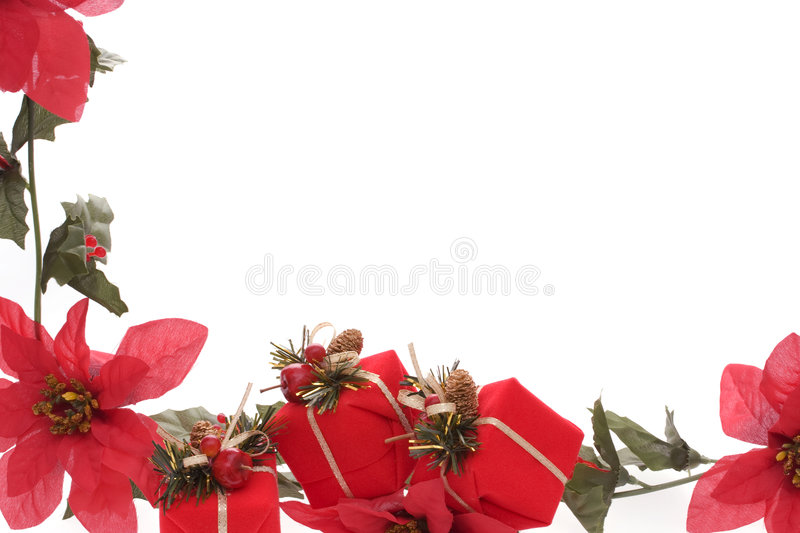 Christmas Border. Poinsettia and red Christmas presents border isolated over white background royalty free stock images