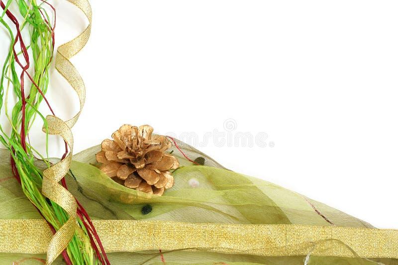 Christmas border. Christmas ribbon and pine cone border / copy space stock image
