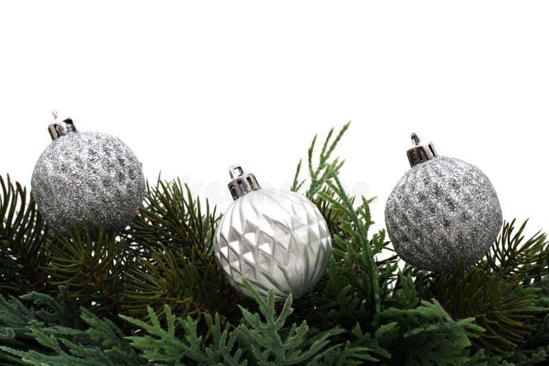 Christmas Border. Christmas tree limb with silver glass ball ornaments on white background, Christmas border stock photos