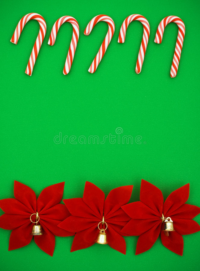 Christmas Border. Candy cane and poinsettia border on green background, Christmas border stock photography