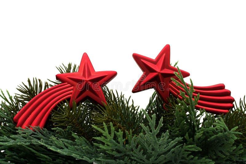 Christmas Border. Christmas tree limb with red star glass ornament on white background, Christmas border stock image