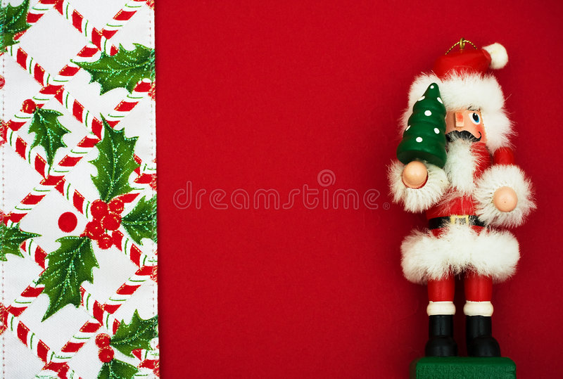 Christmas Border. Nutcracker with holly berries and leaf border on red background, Christmas border stock image