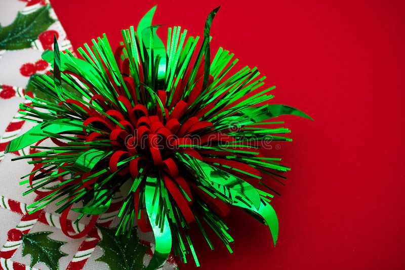 Christmas Border. Green and Red bow with holly berries and leaf border on red background, Christmas border royalty free stock photo