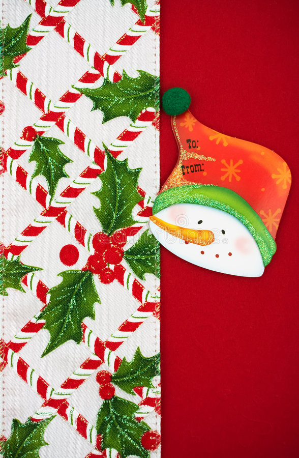 Christmas Border. Snowman gift tag with holly berries and leaf border on red background, Christmas border stock images