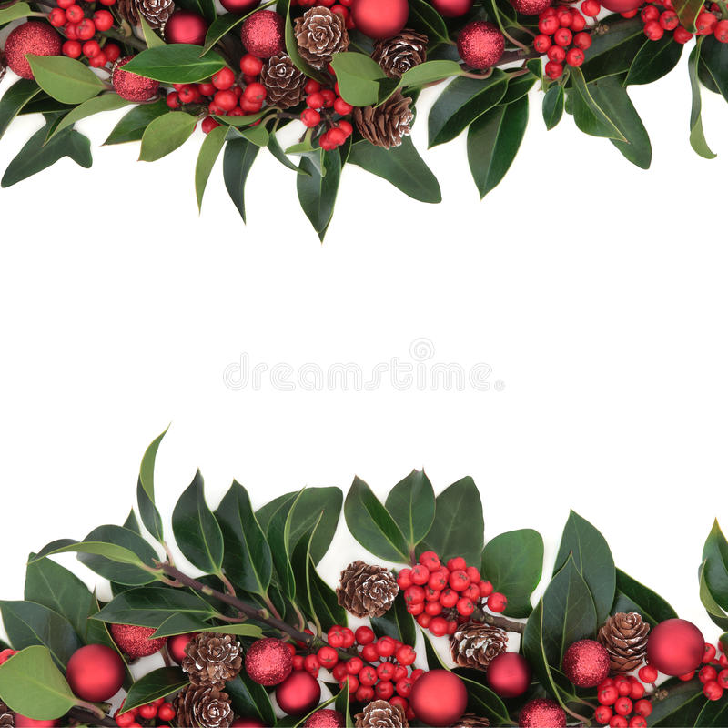 Christmas Border. Christmas background border decoration of holly, red baubles and pine cones over white background royalty free stock images