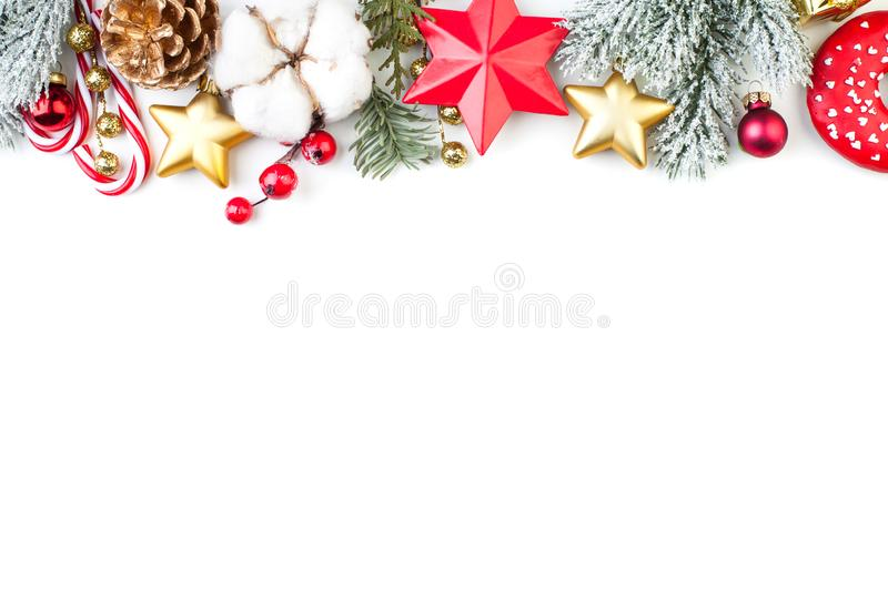 Christmas border or banner with stars, fir branch, holly berries and baubles isolated on white background.  royalty free stock photos