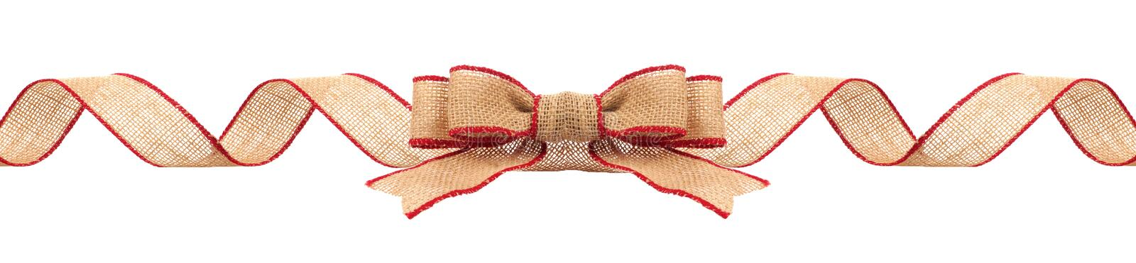 Christmas border with burlap ribbon with red trim isolated stock photo