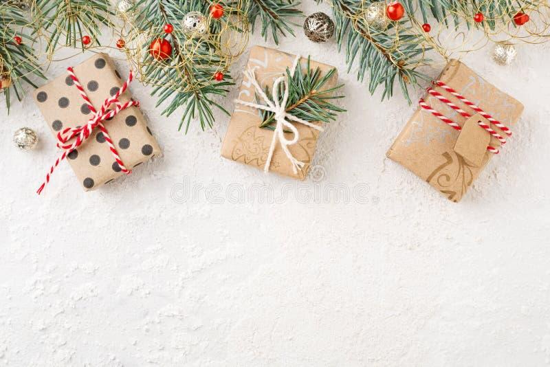 Christmas border of christmas gift boxes, ornaments & spruce on white background. Cristmas border of decorated christmas gift boxes, ornaments & spruce on white stock photos