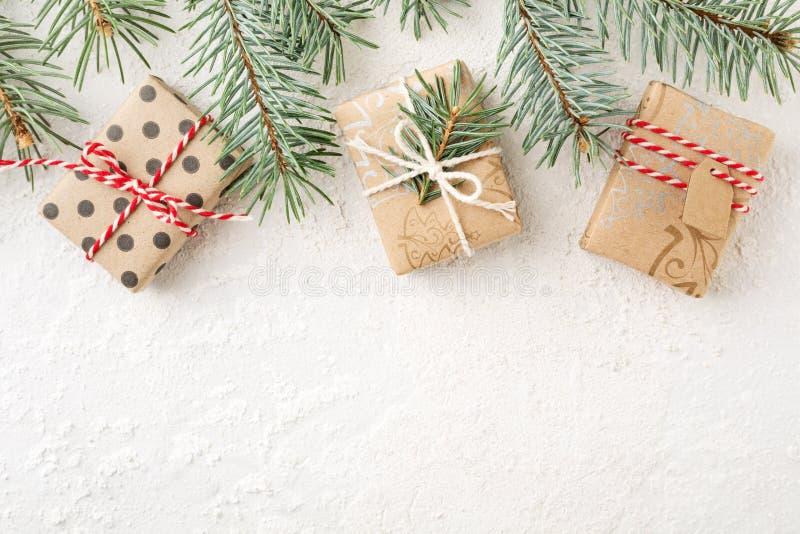 Christmas border of christmas gift boxes & spruce branches on white background. Cristmas border of decorated christmas gift boxes & spruce branches on white royalty free stock photo