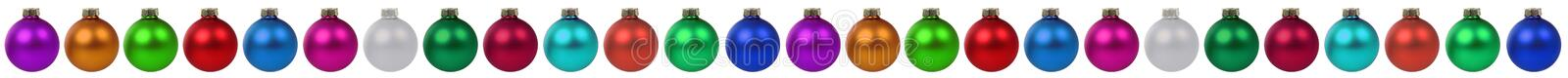 Christmas border colorful balls baubles decoration in a row isol. Ated on a white background stock photo