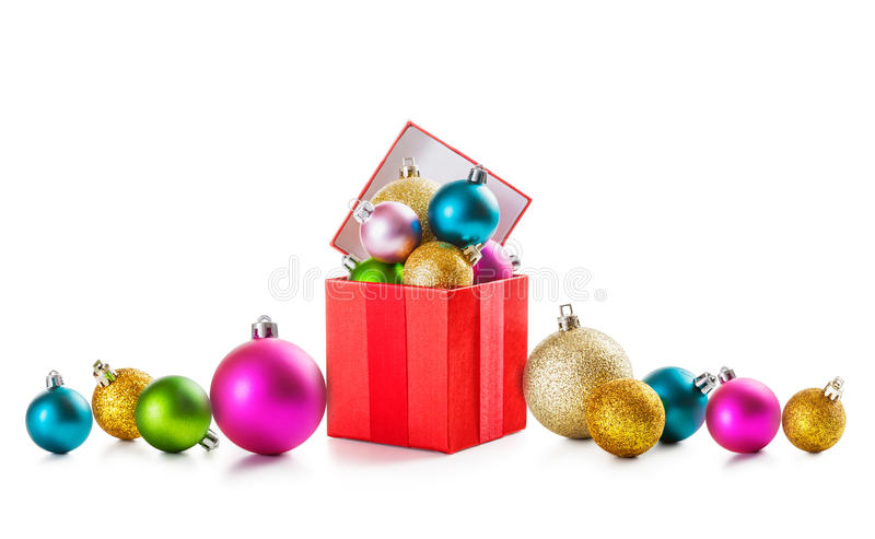 Christmas border. Colorful christmas border with gift box and baubles on white background stock photos