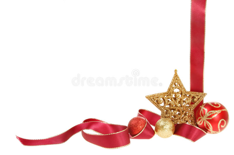 Christmas border with copy space. Christmas border, gold edged red ribbon with baubles and a gold star isolated against white stock image