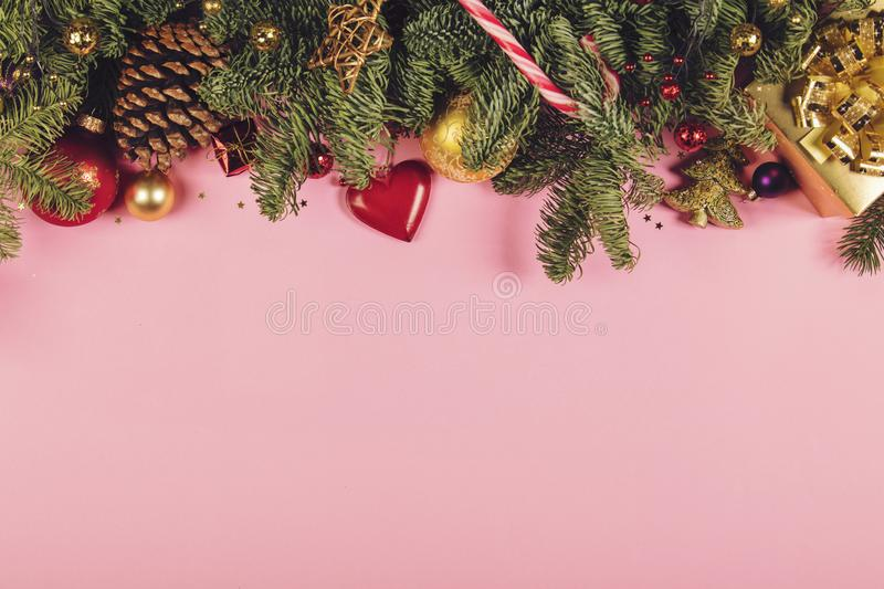 Christmas border with fir branches, conifer cones, christmas balls and golden christmas ornaments royalty free stock photos