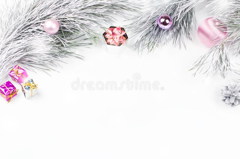 Christmas border with fir branches, presents, christmas ornaments on white background royalty free stock images