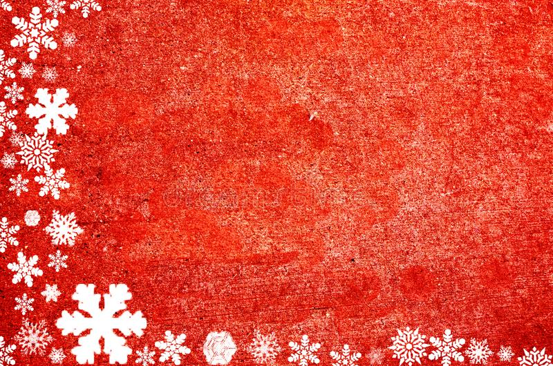 Christmas border formed from snowflakes on red natural background stock photo