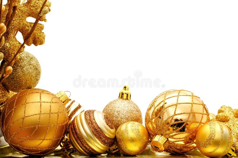 Christmas border. Golden Christmas corner border with baubles and branches royalty free stock photography