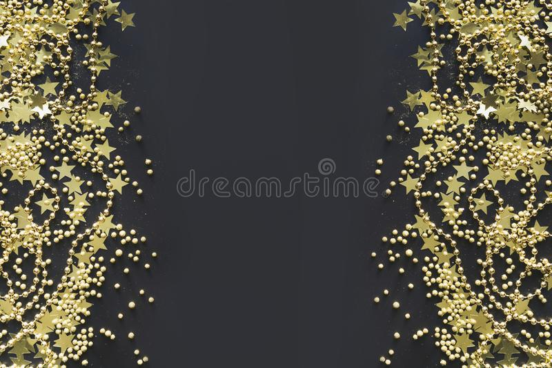 Christmas border with golden decoration on black. Flat lay. View from above. Xmas banner. Flat lay stock photography