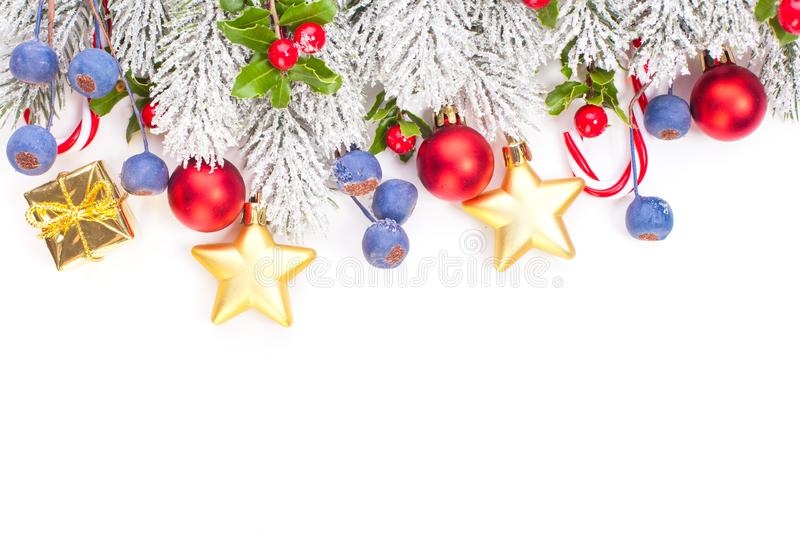 Christmas border with green Xmas tree twig and New Year decoration isolated on white background.  royalty free stock image