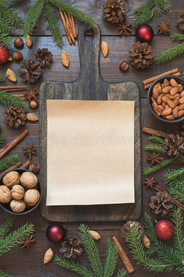Christmas border with ingredient for cooking holiday food with copy space on cutting board. New Year background stock photography