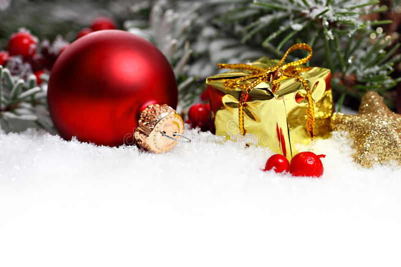 Christmas border with ornament, present and snow. Christmas border with ornament, golden present and snow royalty free stock photography